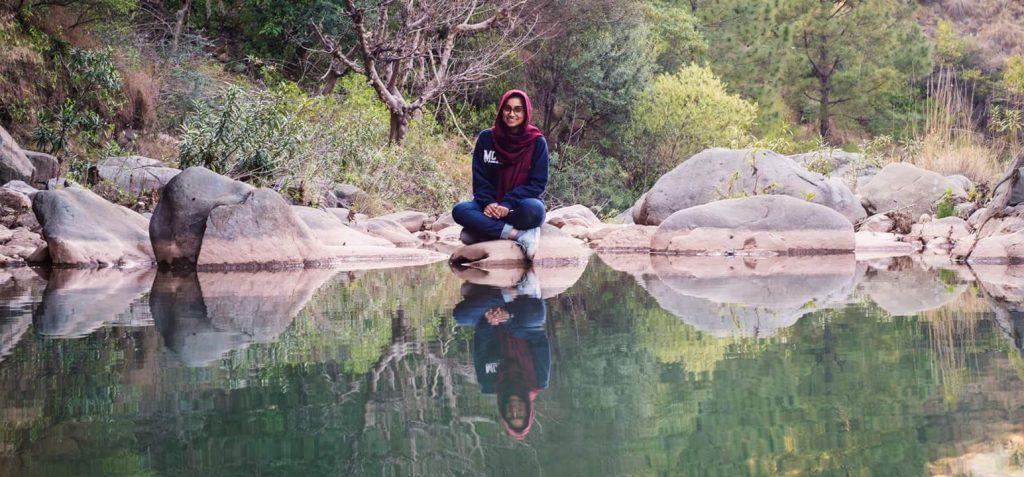 Zukhruf Amjad by a pond