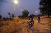 Men on bicycles in rural area